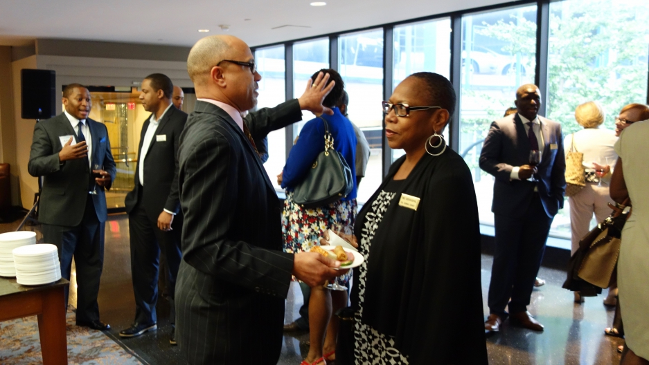Executives meet at an IT Senior Management Forum gathering, a group that mentors senior African-American managers in STEM fields