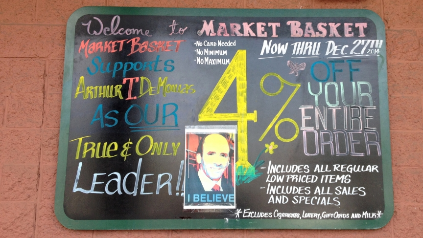 During the worker-led protest, posters of Market Basket's CEO, Arthur T. Demoulas, were plastered to the walls of this grocery store in Somerville, Mass. Arthur T, as he was affectionately called, recently regained control of the company after the board f