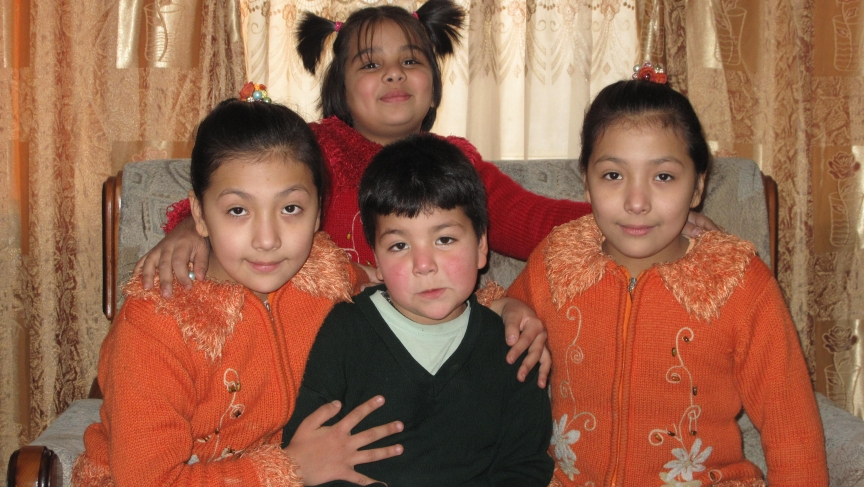 Mehran, a bacha posh featured in the book poses with her sisters