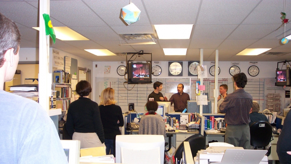 The World's team gathers in March 2003 to talk strategy in covering the war in Iraq
