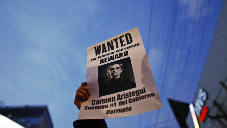 A demonstrator holds a sign of Mexican journalist Carmen Aristegui