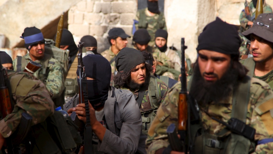 Members of al-Qaeda's Nusra Front gather before moving toward their positions during an offensive to take control of the northwestern Syrian city of Ariha, Idlib province, from forces loyal to President Bashar al-Assad, on May 28, 2015.