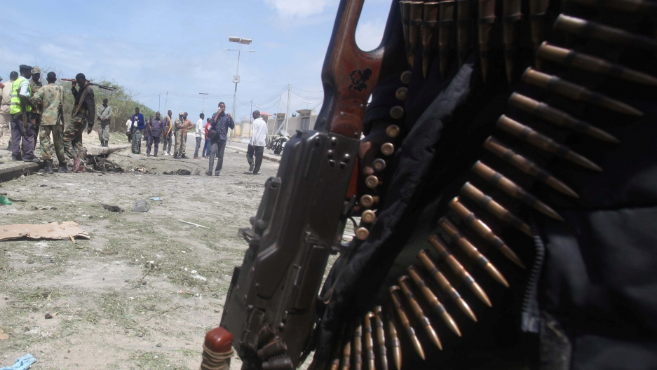 Somali policemen and miltary gather near the scene of a suicide bombing near the African Union's main peacekeeping base in Mogadishu, Somalia, July 26, 2016.