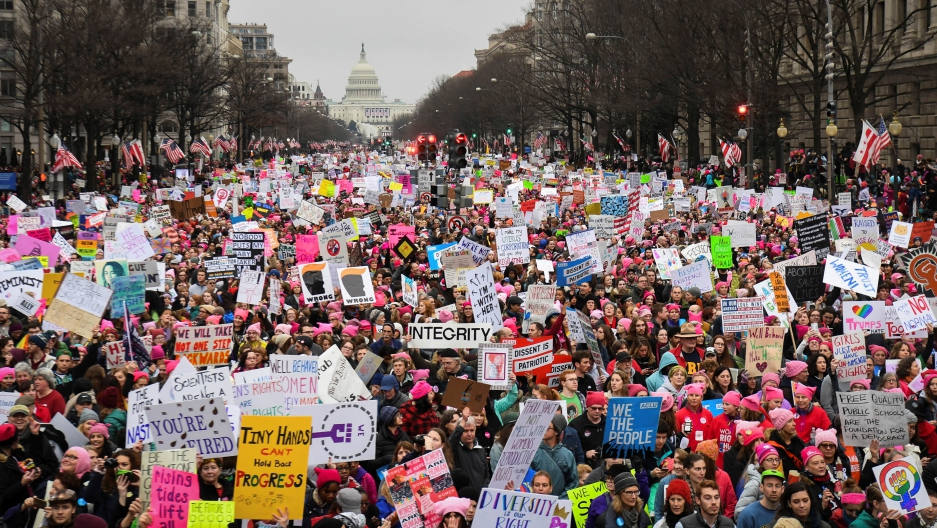 Hundreds of thousands march down Pennsylvania Avenue during the Women's March in Washington, DC, January 21, 2017.