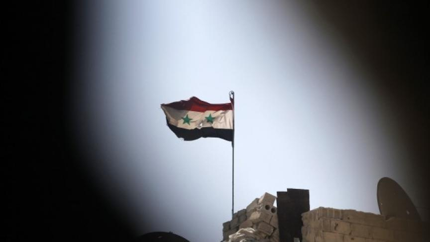 The battle for Syria continues. Here a Syrian national flag can be seen from a rebel position, flying over a building controlled by forces loyal to President Assad in Ashrafieh, Aleppo, September 17th 2013. (Photo: REUTERS/Muzaffar Salman)