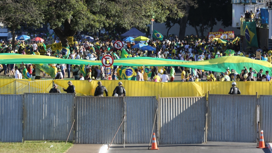 Authorities erected a fence to separate demonstrators for and against Rousseff's impeachment in Brasilia.