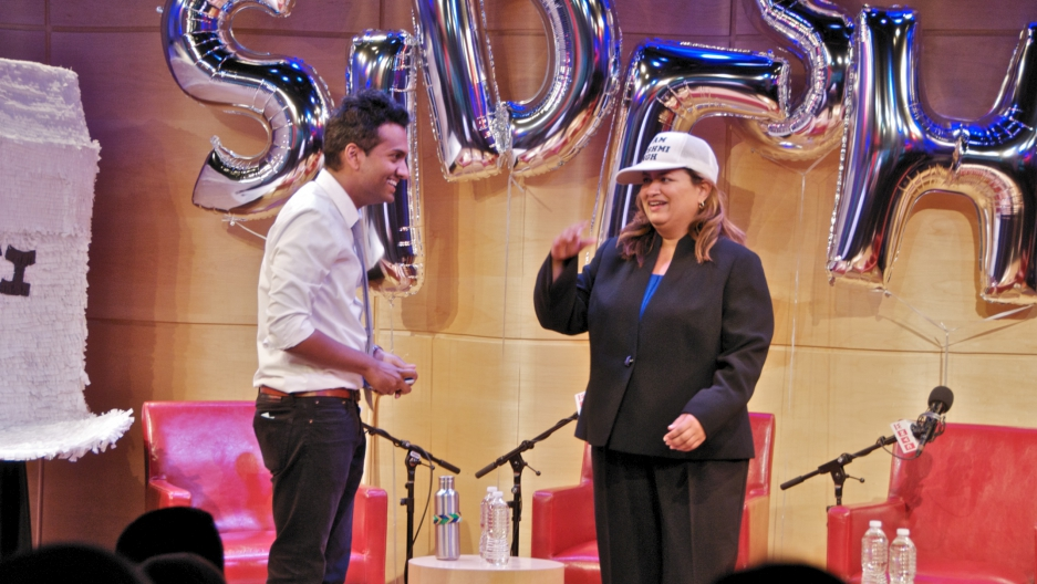 Lakshmi Singh wears the hat