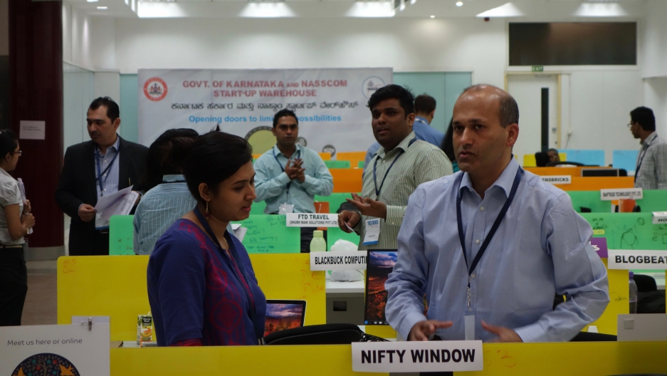 Indian startup entrepreneurs pitch their ideas to potential investors at the Startup Warehouse in Bangalore