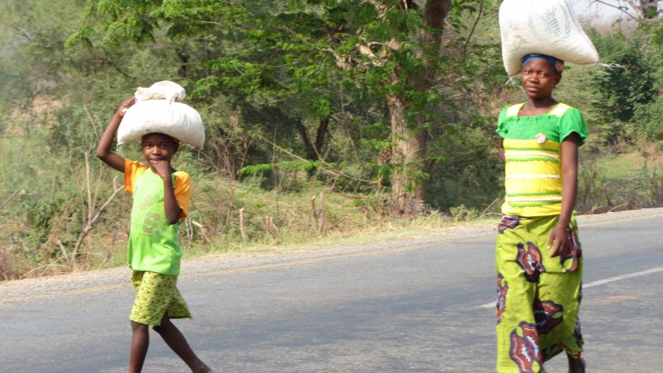 Zambians walking near their village