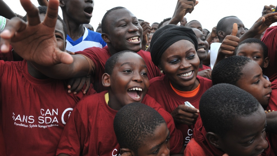 Crowds cheer during an AIDS awareness campaign in Libreville, Gabon, on  February 10, 2012 during the Africa Cup of nations soccer tournament.
