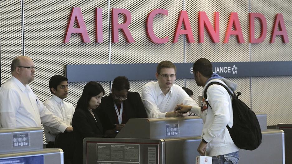 air canada warns of delays as customer service staff go on strike