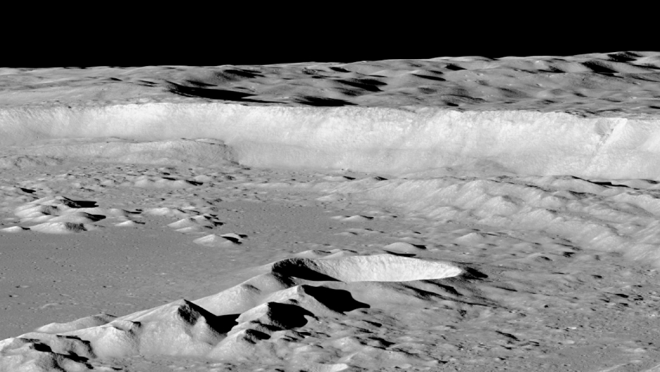 ... reveals the moon s rugged terrain the cliff in the background is the