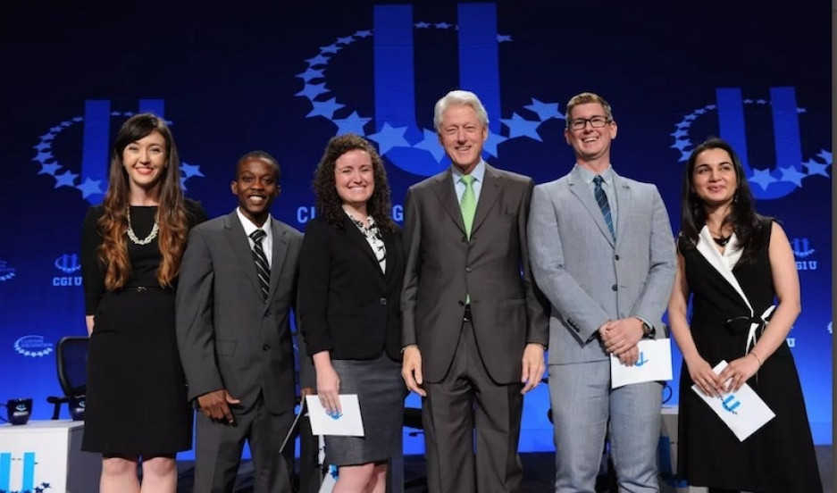 Mariam Adil (far right) onstage at a Clinton Global Initiative University's conference with President Bill Clinton and other commitment makers. Image courtesy GRID Website