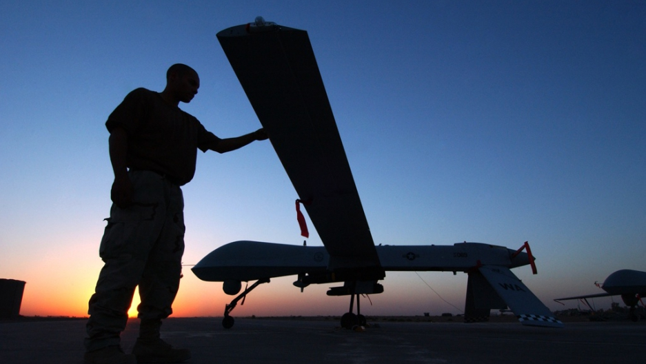A crew chief completes a post flight inspection of a Predator drone on Sept. 15, 2004 at Balad Air Base, Iraq.