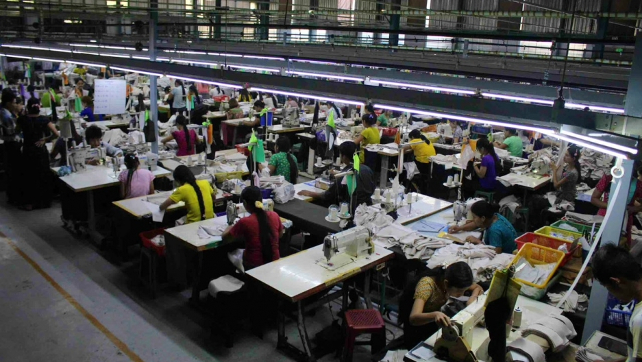Rows of garment workers work on a factory floor in Myanmar