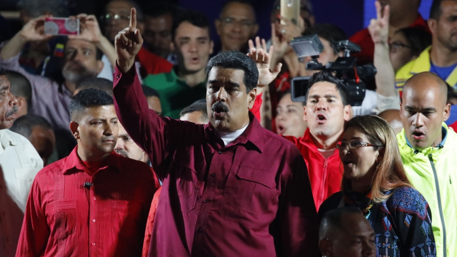Venezuela's President Nicolas Maduro raises a finger