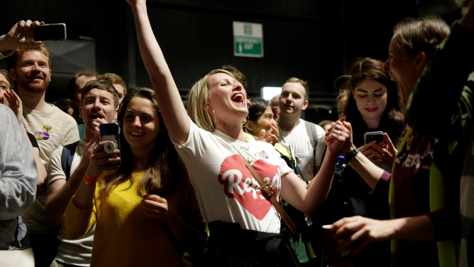 Activists react at the count centre
