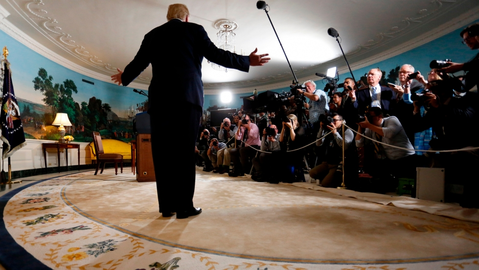 President Donald Trump reacts to a question from a reporter after the president announced his intention to withdraw from the Iran nuclear agreement.
