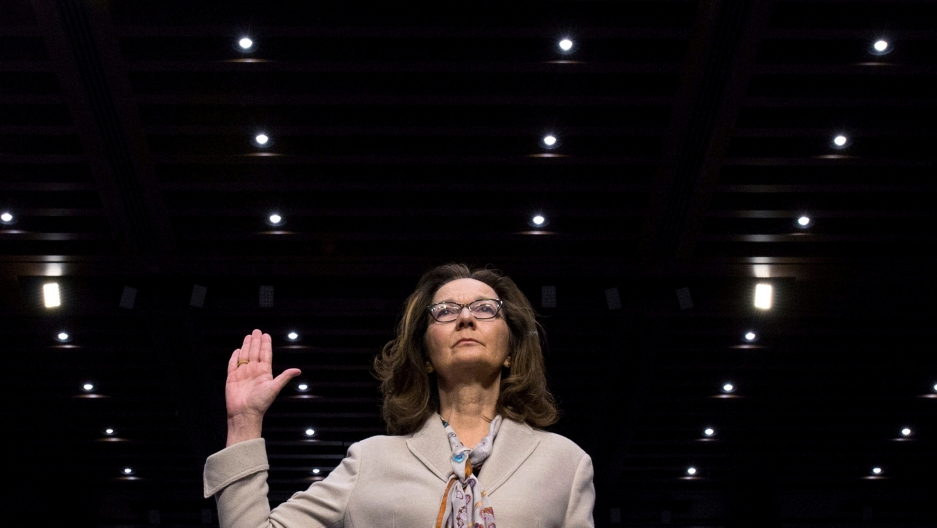 CIA director nominee Gina Haspel raises her right hand as she is sworn in to testify at her Senate Intelligence Committee confirmation, May 9, 2018.