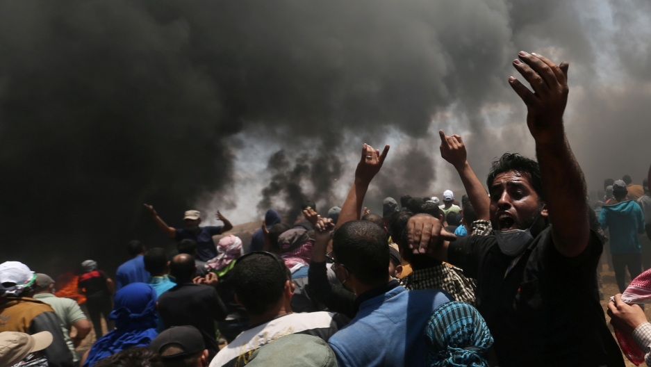Palestinian demonstrators react during a protest against the US embassy move to Jerusalem.