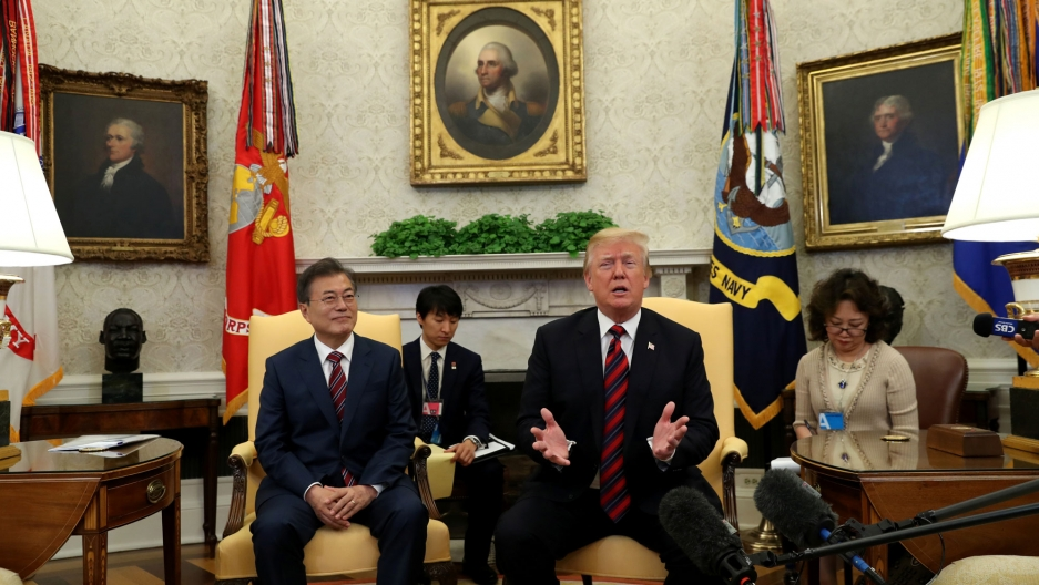 Donald Trump and Moon Jae-In sit in large chairs in the White House