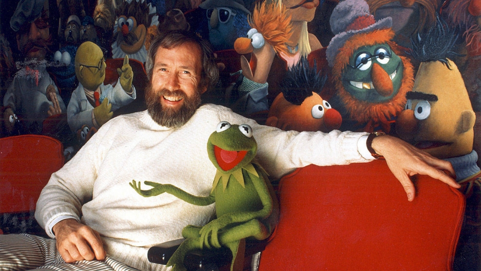 Jim Henson and his creation, Kermit the Frog, sit in front of a mural by Coulter Watt.