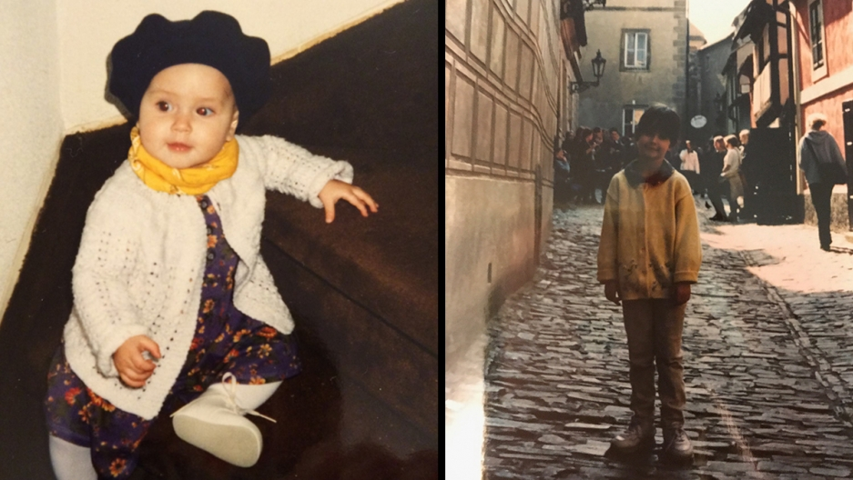 a baby sitting on steps and a child on a cobblestone street