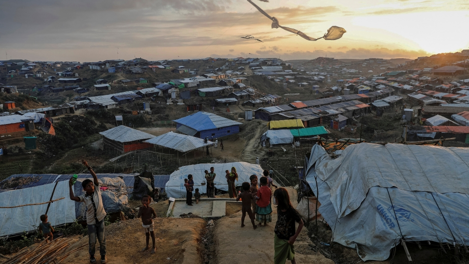 Rohingya refugee children fly improvised kites at the Kutupalong refugee camp near Cox's Bazar, Bangladesh.