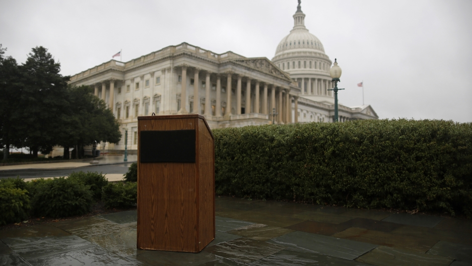 An empty speaker's lectern is seen in the rain outside the US Capitol in Washington, October 10, 2013.
