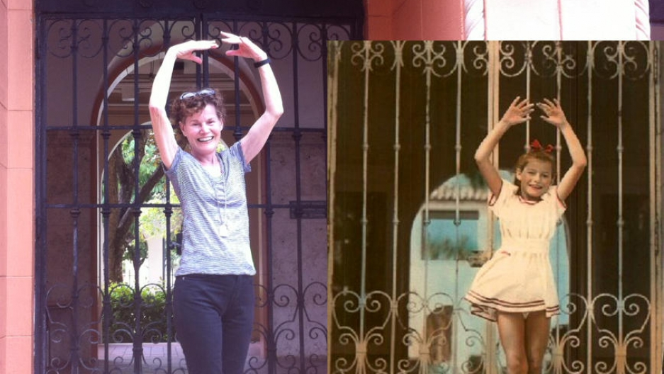 Judy Blume and her younger self pose in front of her childhood apartment building in Miami Beach.