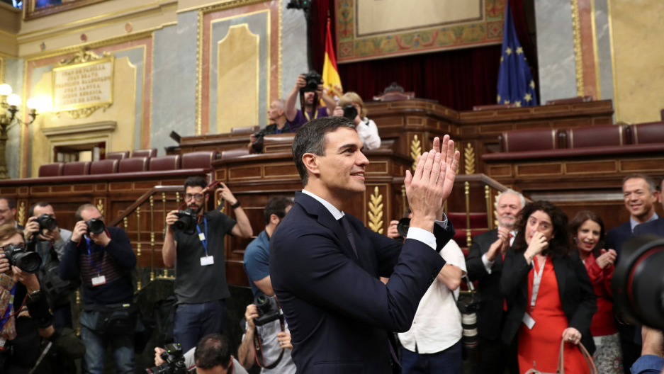 Spain's new prime minister, Pedro Sanchez, smiles.