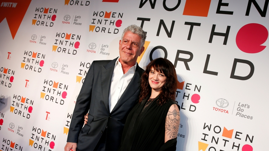Anthony Bourdain poses with Italian actor and director Asia Argento