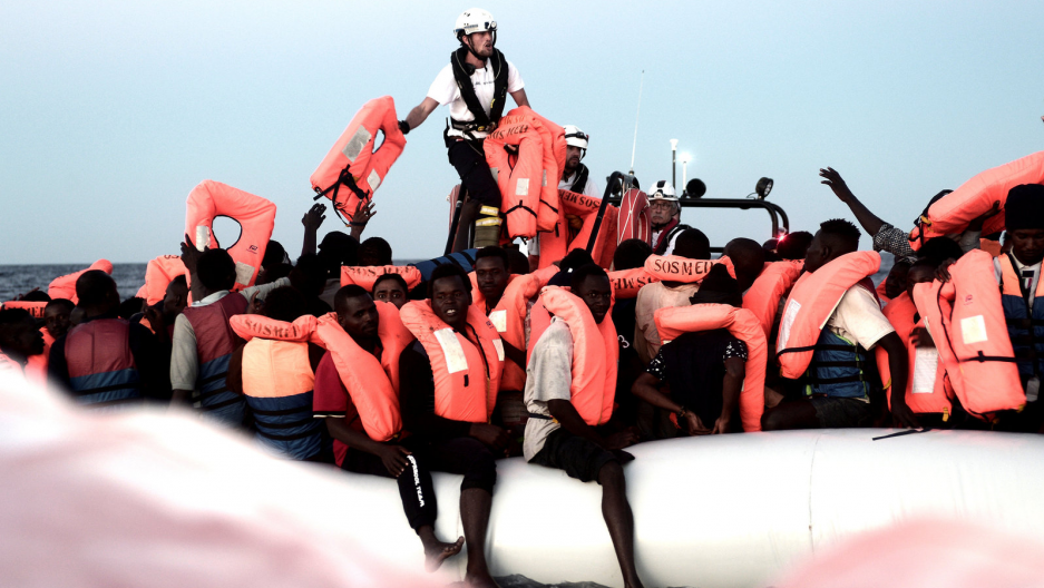 refugees are rescued on the Mediterranean Sea