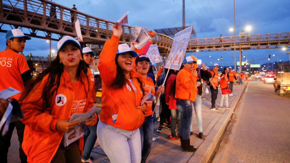 Supporters cheer with the leaflets and placards ahead of the second round of presidential election in Soacha, Colombia, June 11, 2018.