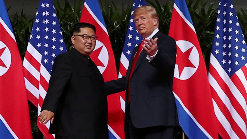 Presiden Donald Trump and leader Kim Jung-un meet at a historic summit.