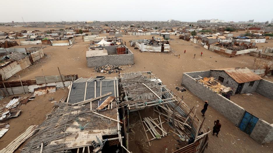 People walk in a shantytown