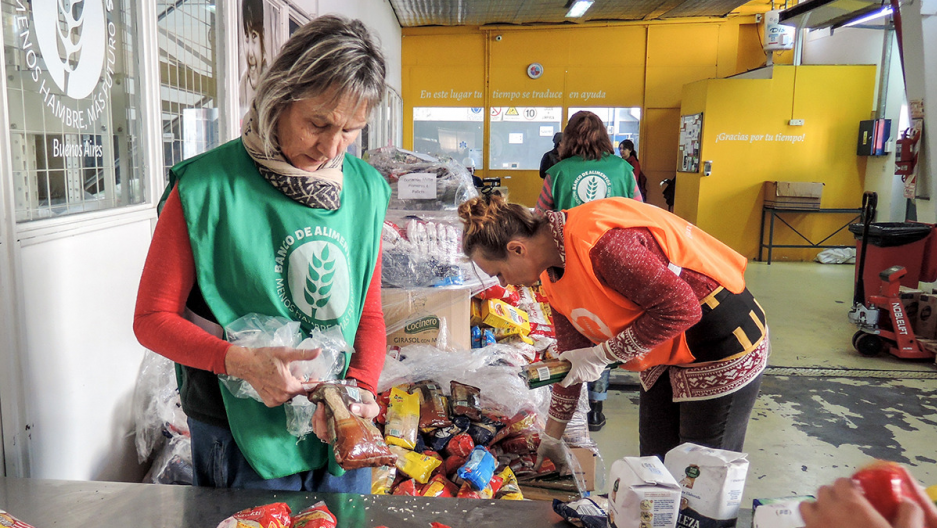 volunteers pack food at a food bank in Buenos Aires, Argentina