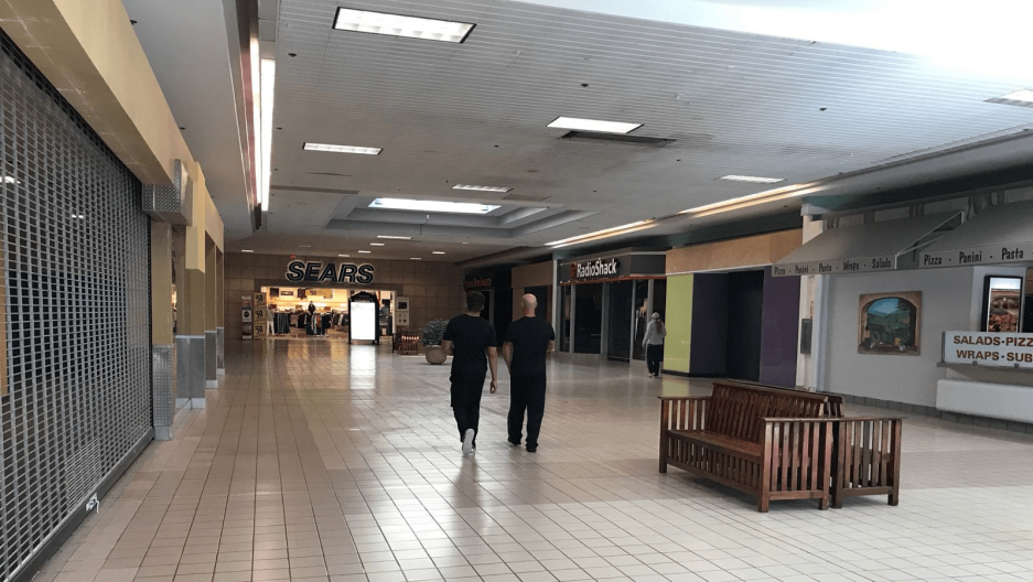 the interior of a nearly abandoned shopping mall in the US