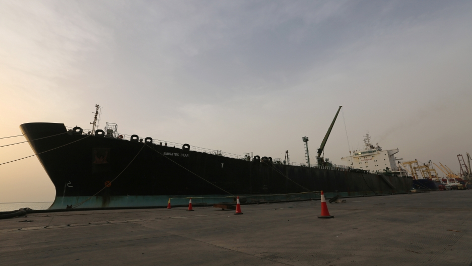 A cargo ship unloads a shipment of fuel at the Hodeida port, May 27, 2018.