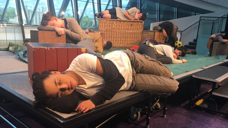 "Yusra, played by Rhianna Merralls, struggles to fall asleep in the play, ""Wherever I Lay My Head,"" performed in London City Hall."