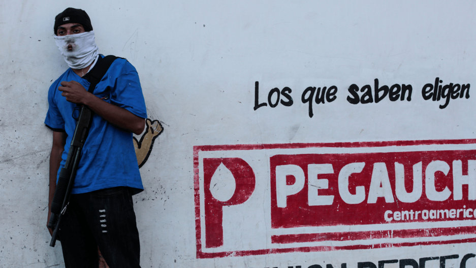 a nicaraguan paramilitary soldier on the streets of Monimbo.