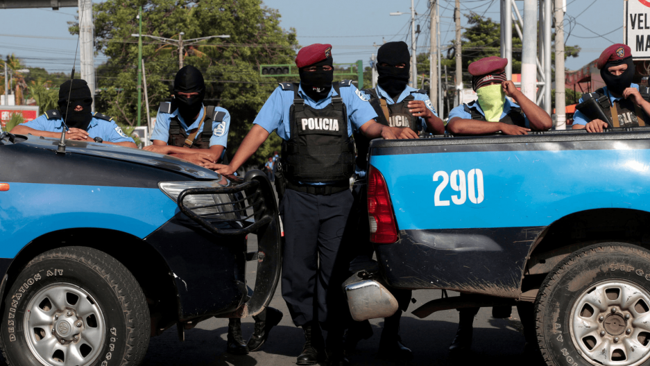 Masked police block the entrance of Divine Mercy Catholic Church in Managua, Nicaragua,