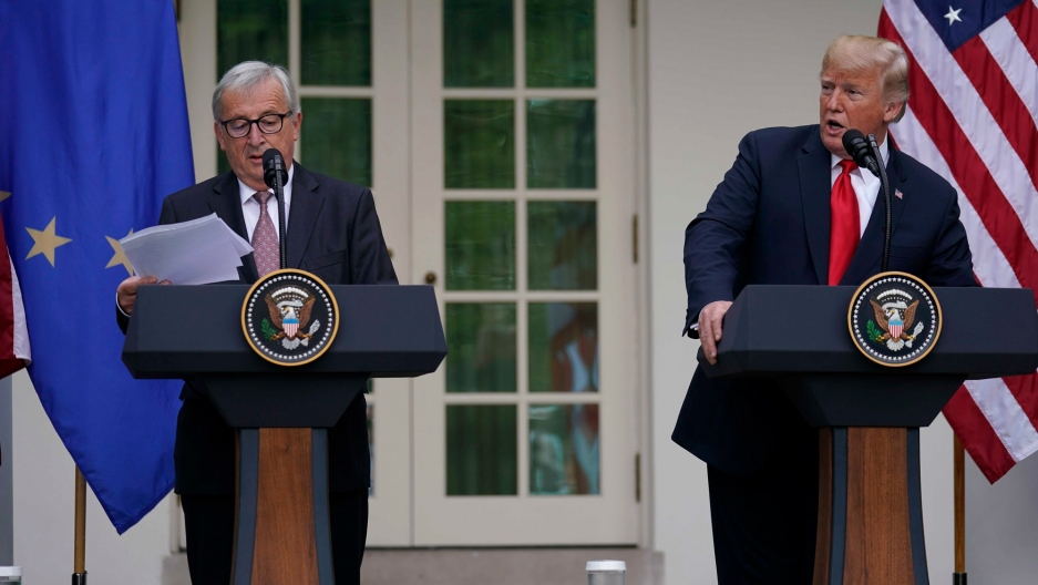 European Commission President Jean-Claude Juncker and US President Donald Trump stand at podiums in the Rose Garden of the White House, July 25, 2018.