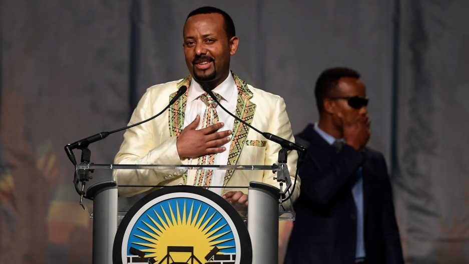 Ethiopian Prime Minister Abiy Ahmed stands at a podium with his hand on his heart as he speaks in Washington DC, July 28, 2018.