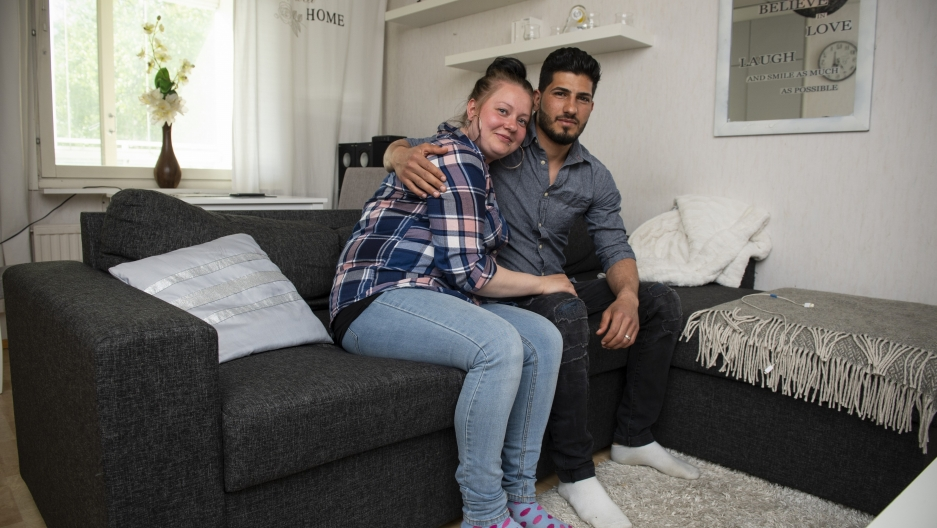 Haitham Dagher and his girlfriend Satu in their apartment in Oulu