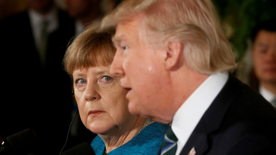 Germany's Chancellor Angela Merkel and President Donald Trump hold a joint news conference in the East Room of the White House in Washington, DC, March 17, 2017.