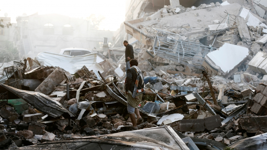 Man stands on pile of rubble