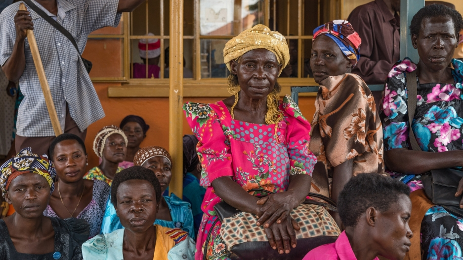 Patients wait to collect their HIV medication in Uganda at Mayuge Health Centre III in Uganda.