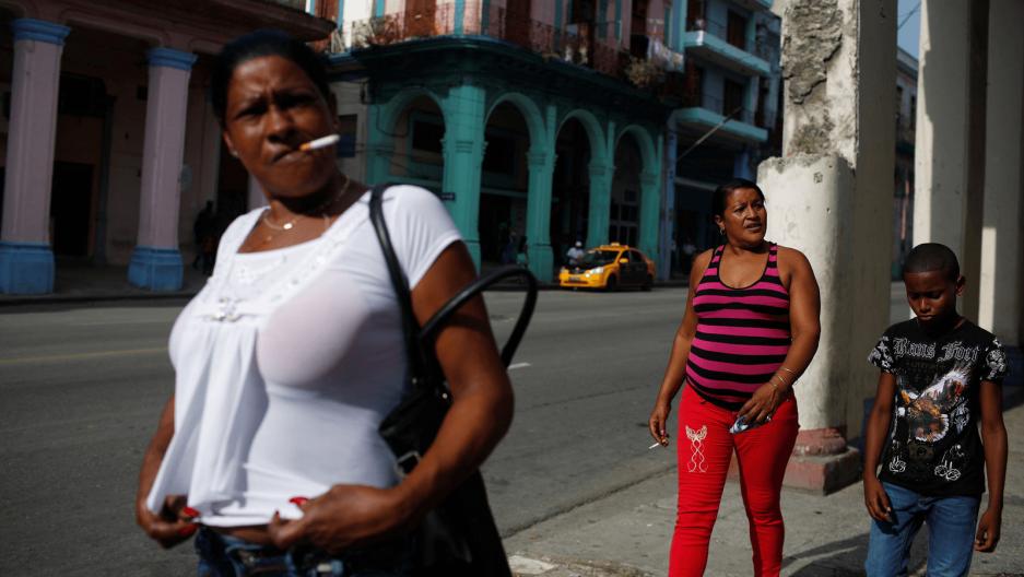 people on the street walking in havana