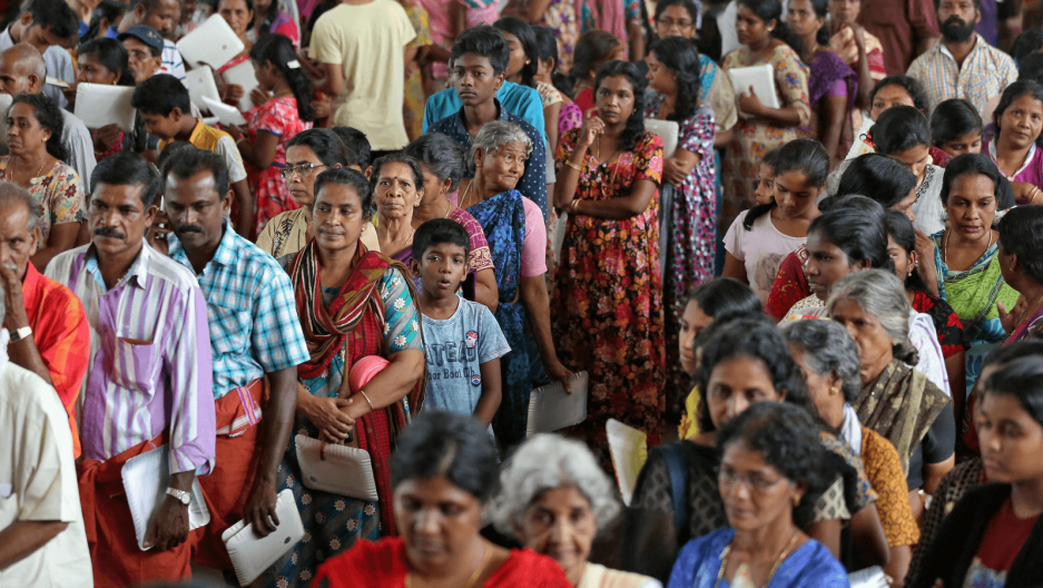 hundreds of people wait for aid in Kerala, India after floods